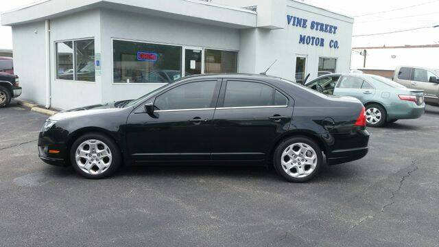 2011 Ford Fusion for sale at VINE STREET MOTOR CO in Urbana IL