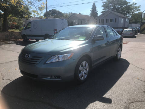 2009 Toyota Camry for sale at MIRACLE AUTO SALES in Cranston RI