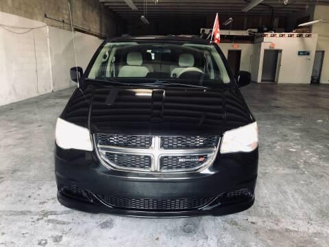 2014 Dodge Grand Caravan for sale at Auto Credit & Finance Corp. in Miami FL