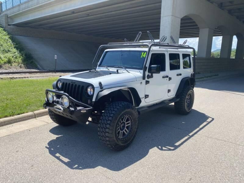 2014 Jeep Wrangler Unlimited for sale at Apple Auto in La Crescent MN