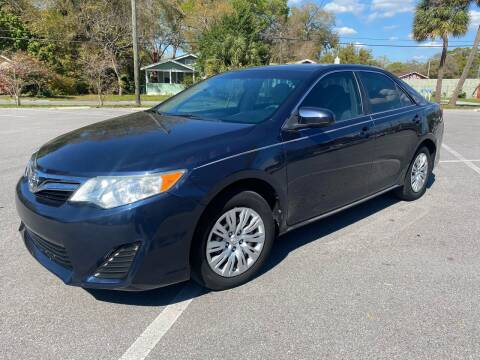 2014 Toyota Camry for sale at CHECK  AUTO INC. in Tampa FL