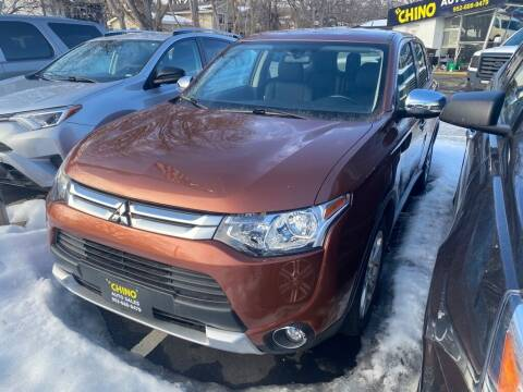 2015 Mitsubishi Outlander for sale at Chinos Auto Sales in Crystal MN