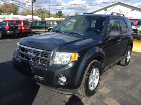 2009 Ford Escape for sale at Steves Auto Sales in Cambridge MN