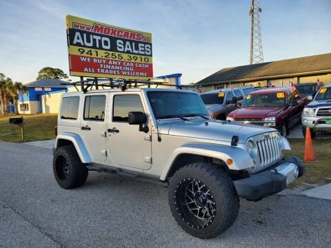 2011 Jeep Wrangler Unlimited for sale at Mox Motors in Port Charlotte FL