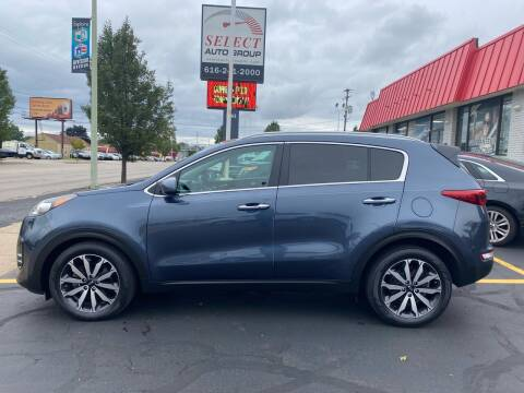 2017 Kia Sportage for sale at Select Auto Group in Wyoming MI