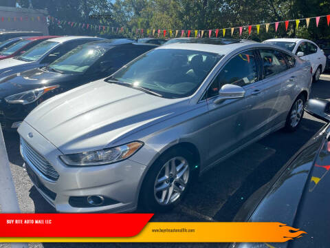 2014 Ford Fusion for sale at BUY RITE AUTO MALL LLC in Garfield NJ