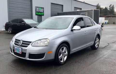2009 Volkswagen Jetta for sale at DASH AUTO SALES LLC in Salem OR