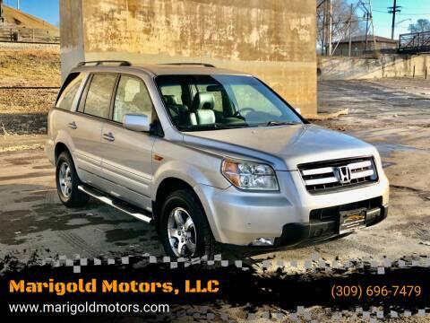 2006 Honda Pilot for sale at Marigold Motors, LLC in Pekin IL