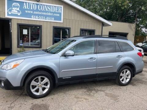 2014 Subaru Outback for sale at Auto Consider Inc. in Grand Rapids MI