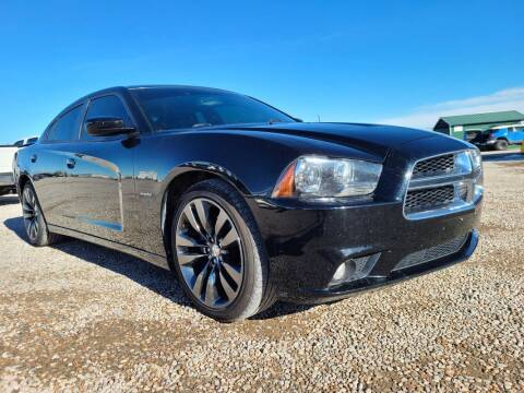 2014 Dodge Charger for sale at BERKENKOTTER MOTORS in Brighton CO