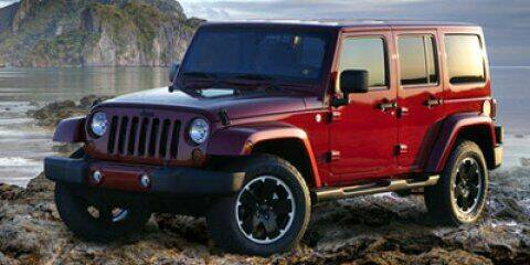 2012 Jeep Wrangler Unlimited for sale at Park Place Motor Cars in Rochester MN