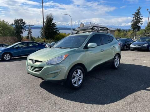 2011 Hyundai Tucson for sale at KARMA AUTO SALES in Federal Way WA