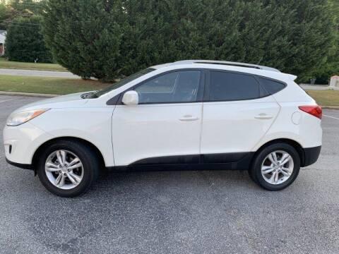 2010 Hyundai Tucson for sale at JES Auto Sales LLC in Fairburn GA