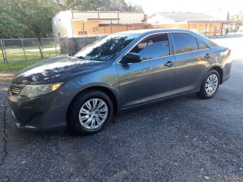 2013 Toyota Camry for sale at Royal Auto Mart in Tampa FL