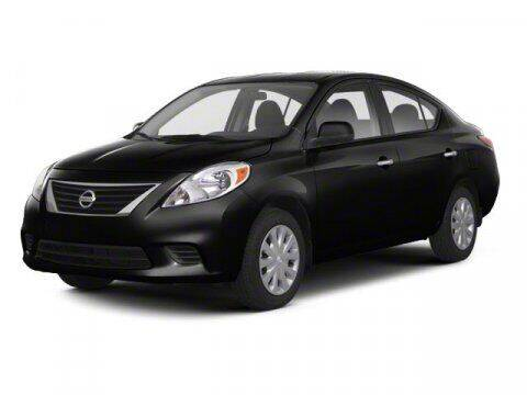 2013 Nissan Versa for sale at HILAND TOYOTA in Moline IL