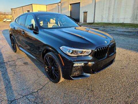 2021 BMW X6 for sale at International Motor Group LLC in Hasbrouck Heights NJ