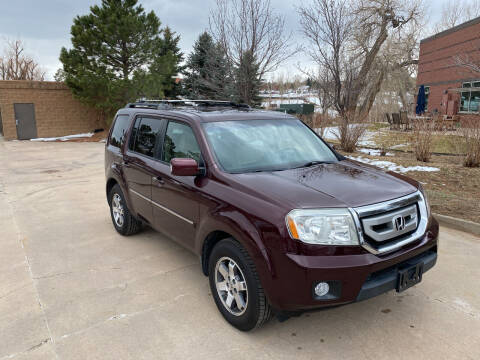 2009 Honda Pilot for sale at QUEST MOTORS in Englewood CO
