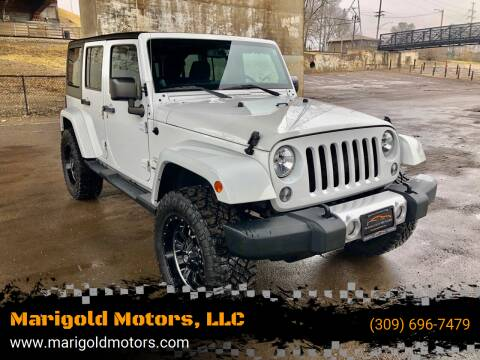 2014 Jeep Wrangler Unlimited for sale at Marigold Motors, LLC in Pekin IL