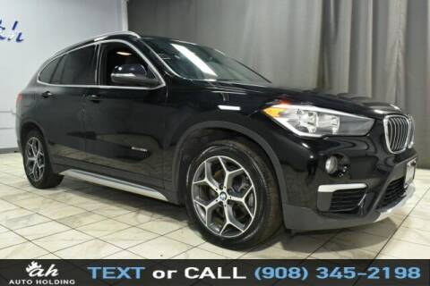 2017 BMW X1 for sale at AUTO HOLDING in Hillside NJ