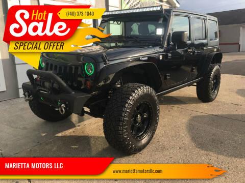 2011 Jeep Wrangler Unlimited for sale at MARIETTA MOTORS LLC in Marietta OH