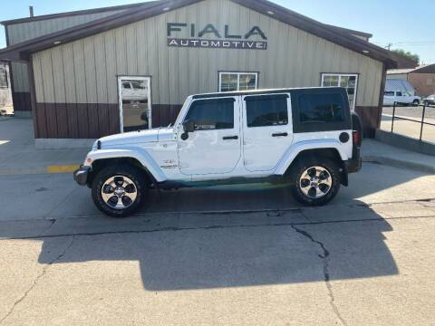 2016 Jeep Wrangler Unlimited for sale at Fiala Automotive in Howells NE