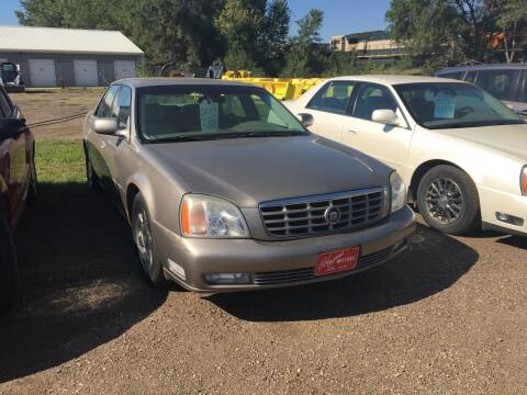 2001 Cadillac DeVille for sale at BARNES AUTO SALES in Mandan ND