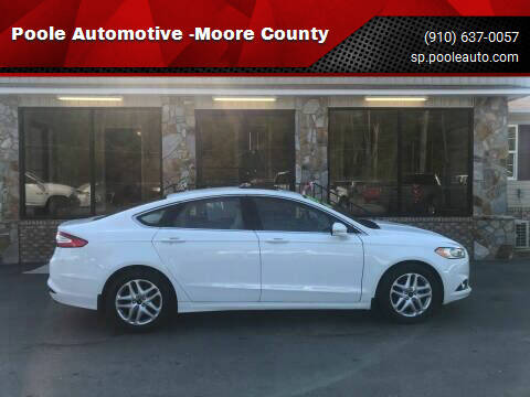 2014 Ford Fusion for sale at Poole Automotive in Laurinburg NC