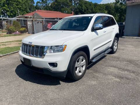2013 Jeep Grand Cherokee for sale at American Best Auto Sales in Uniondale NY