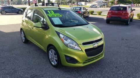 2013 Chevrolet Spark for sale at HCC AUTO SALES INC in Sarasota FL