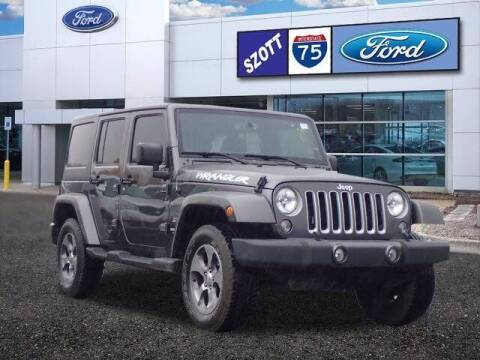 2017 Jeep Wrangler Unlimited for sale at Szott Ford in Holly MI
