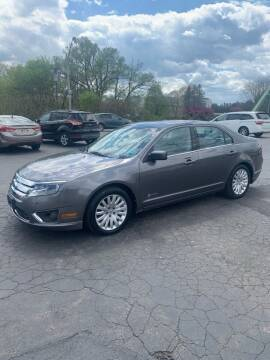 2012 Ford Fusion Hybrid for sale at WXM Auto in Cortland NY