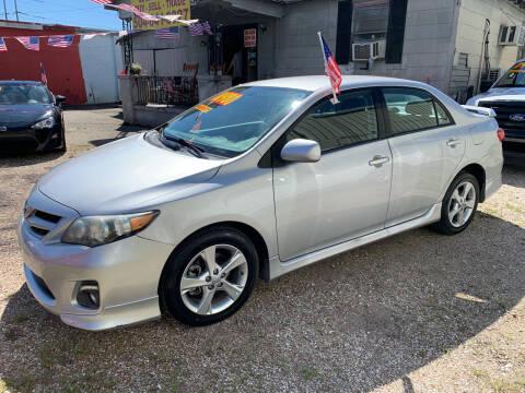 2013 Toyota Corolla for sale at CHEAPIE AUTO SALES INC in Metairie LA