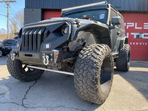 2012 Jeep Wrangler for sale at Apple Auto Sales Inc in Camillus NY
