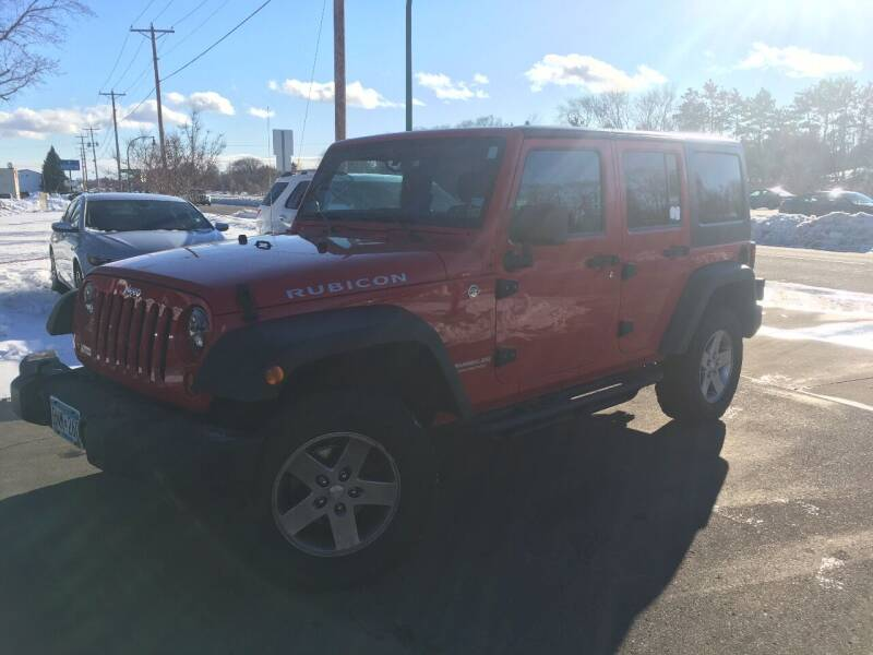 2012 Jeep Wrangler Unlimited for sale at Premier Motors LLC in Crystal MN
