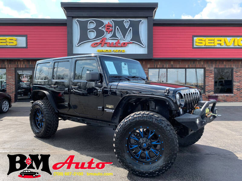 2016 Jeep Wrangler Unlimited for sale at B & M Auto Sales Inc. in Oak Forest IL