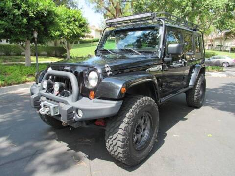 2010 Jeep Wrangler Unlimited for sale at E MOTORCARS in Fullerton CA