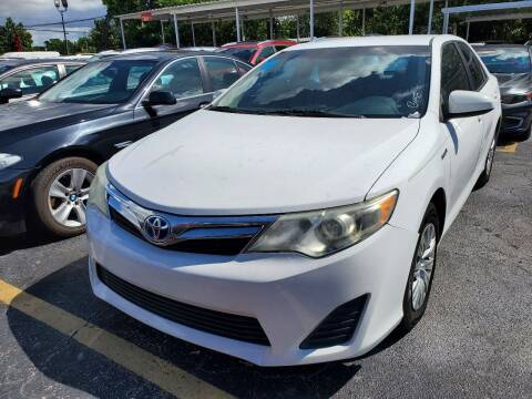 2012 Toyota Camry Hybrid for sale at America Auto Wholesale Inc in Miami FL