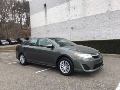 2013 Toyota Camry for sale at Select Auto in Smithtown NY