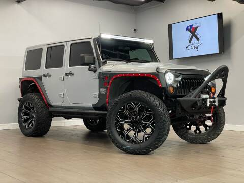 2012 Jeep Wrangler Unlimited for sale at TX Auto Group in Houston TX