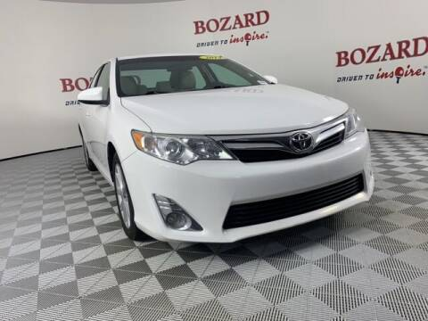 2014 Toyota Camry for sale at BOZARD FORD in Saint Augustine FL
