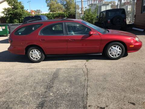1999 Ford Taurus for sale at GLOBAL AUTOMOTIVE in Gages Lake IL