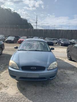 2005 Ford Taurus for sale at J D USED AUTO SALES INC in Doraville GA