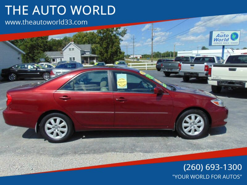 2004 Toyota Camry for sale at THE AUTO WORLD in Churubusco IN