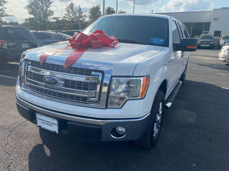 2014 Ford F-150 for sale at Charlotte Auto Group, Inc in Monroe NC