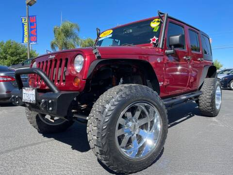 2013 Jeep Wrangler Unlimited for sale at River Park Automotive Center in Fresno CA