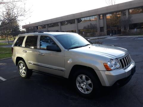 2010 Jeep Grand Cherokee for sale at QUEST MOTORS in Englewood CO