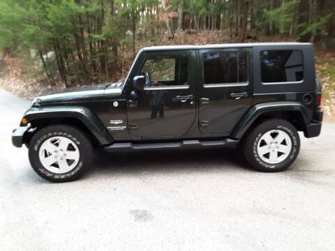 2010 Jeep Wrangler Unlimited for sale at H P M Sales in Goffstown NH