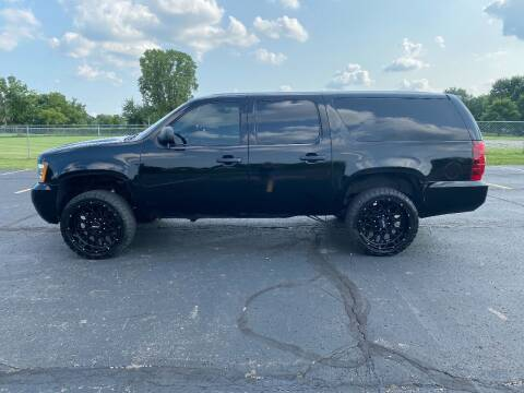 2013 Chevrolet Suburban for sale at Caruzin Motors in Flint MI