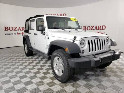 2018 Jeep Wrangler JK Unlimited for sale at BOZARD FORD in Saint Augustine FL