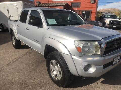 2005 Toyota Tacoma for sale at BERKENKOTTER MOTORS in Brighton CO